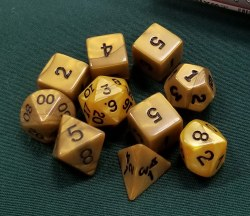 10-set Dice Tube Gold Olympic with Black