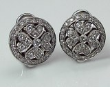 Diamond earrings with flower design 18ktw .70cttw F VS