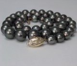 Black Tahitian pearl strand 9-13mm 14kt yellow gold