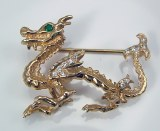 Dragon pin 14kt yellow gold .21cttw 20 diamonds and 1 emerald