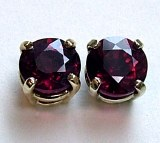Ruby stud earrings .64cttw 14kt white gold