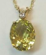 Yellow citrine 16.09 carat oval cut 14kt yellow gold 0.15carat diamond model 273-3582