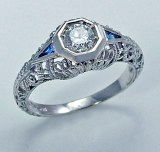 Diamond and sapphire ring .56cttw .33ct center rd GC5007