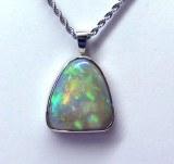 Opal Pendant 10.99 carat triangular cut set in 14kt white gold custom frame model SWP-Opal-1099