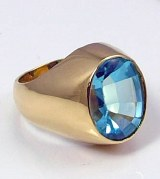 Blue topaz ring 18kt yellow gold 6.49ct