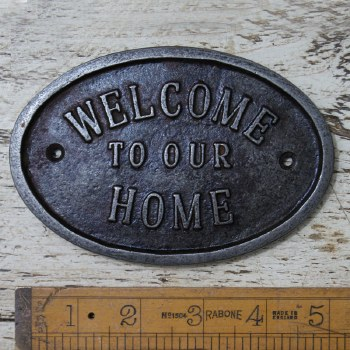 WELCOME TO OUR HOME sign Waxed Cast Iron