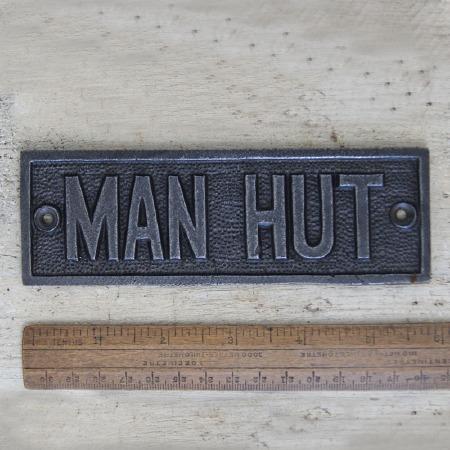 MAN HUT sign Waxed Cast Iron