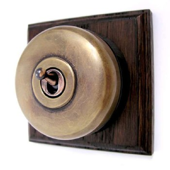 Round Dolly Light Switch on Wooden Base Antique Satin Brass 1 Gang