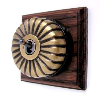 Fluted Round Dolly Light Switch on Wooden Base Antique Satin Brass 1 Gang