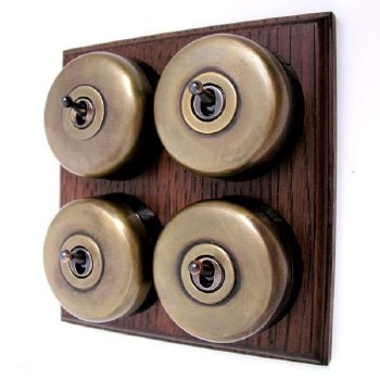 Round Dolly Light Switch on Wooden Base Antique Satin Brass 4 Gang