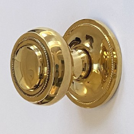 Aston Regency Centre Door Knob Polished Brass Unlacquered