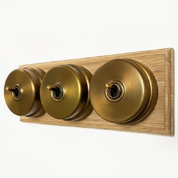 Citadel Dolly Switch on Wooden Base 3 Gang Antique Satin Brass