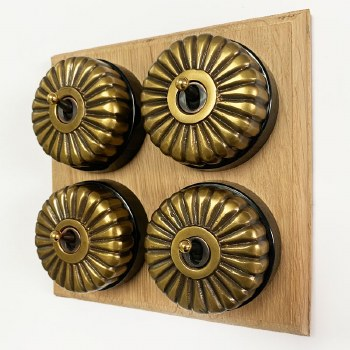 Fluted Round Dolly Light Switch on Wooden Base Antique Satin Brass 4 Gang