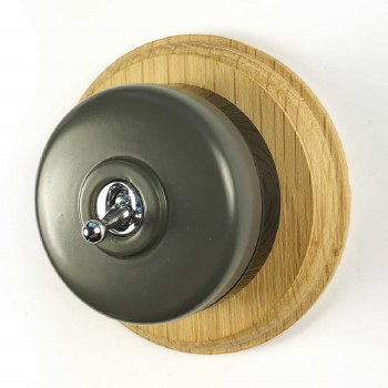 Round Dolly Light Switch Grey on Circular Oak Base with Black Mount