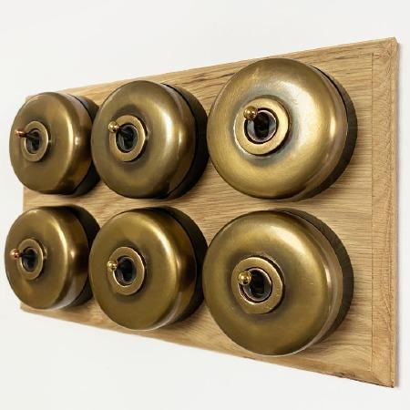 Round Dolly Light Switch on Oak Base 6 Gang Antique Satin Brass