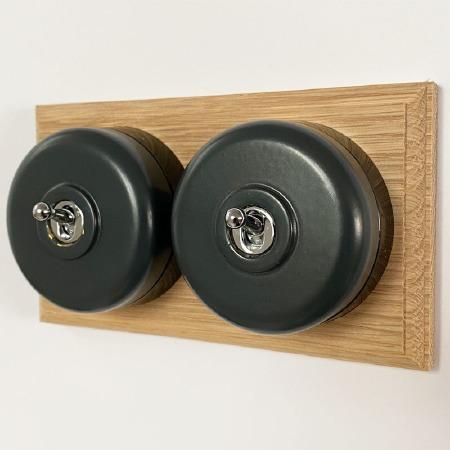 Round Dolly Light Switch 2 Gang Dark Grey on Oak Pattress with Black Mounts