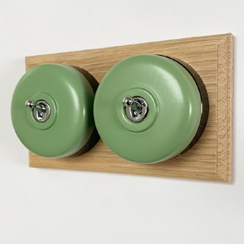Round Dolly Light Switch 2 Gang Green on Oak Pattress with Black Mounts