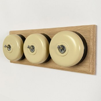 Round Dolly Light Switch 3 Gang Stone on Oak Pattress with Black Mount