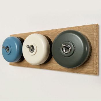 Round Dolly Light Switch 3 Gang Mix and Match on Oak Pattress with Black Mounts