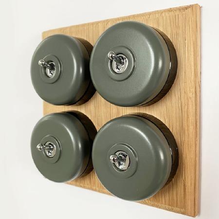 Round Dolly Light Switch 4 Gang Light Grey on Oak Pattress with Black Mounts