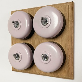 Round Dolly Light Switch 4 Gang Lilac on Oak Pattress with Black Mounts