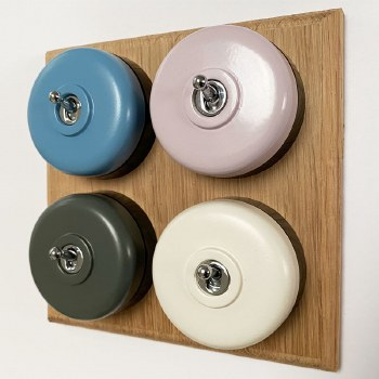 Round Dolly Light Switch 4 Gang Mix and Match on Oak Pattress with Black Mounts