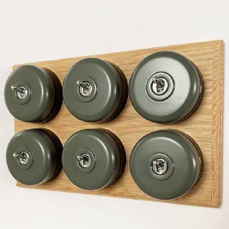 Round Dolly Light Switch 6 Gang Light Grey on Oak Pattress with Black Mounts