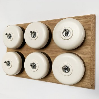 Round Dolly Light Switch 6 Gang White on Oak Pattress with Black Mounts