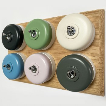 Round Dolly Light Switch 6 Gang Mix and Match on Oak Pattress with White Mounts