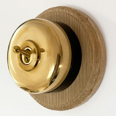 Round Dolly Light Switch on Circular Oak Base Polished Brass & Black Mount