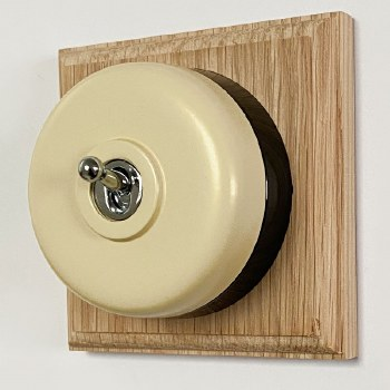 Round Dolly Light Switch Stone on Square Oak Pattress with Black Mount