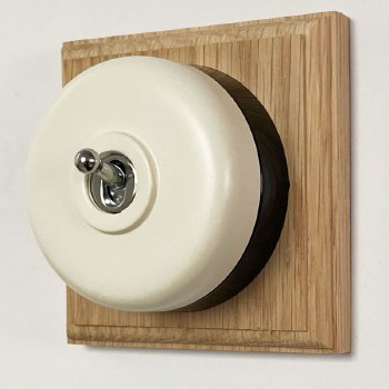Round Dolly Light Switch White on Square Oak Pattress with Black Mount