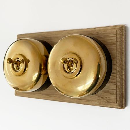 Round Dolly Light Switch on Oak Base Polished Brass 2 Gang