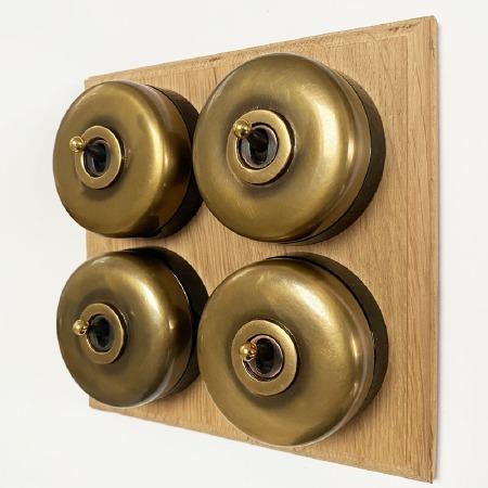 Round Dolly Light Switch on Oak Base Antique Satin Brass 4 Gang