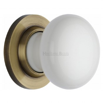 Heritage Porcelain Door Knobs White with Antique Brass Rose
