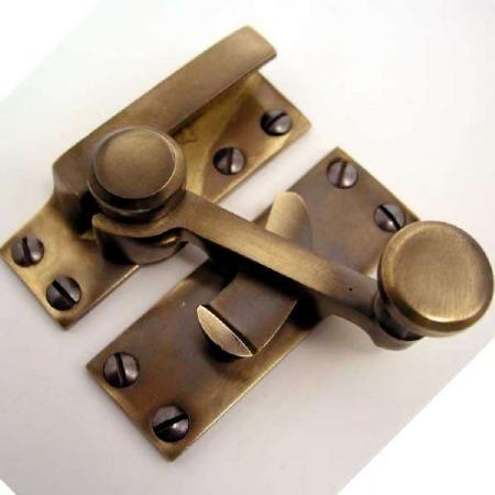 Quadrant Sash Fastener Antique Brass Unlacquered