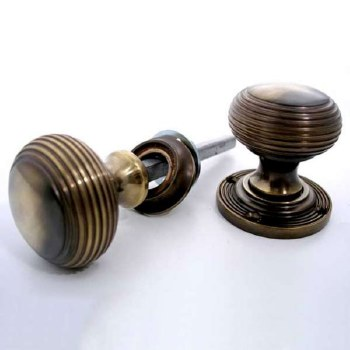 Aston Reeded Bun Rim Knobs 44mm Antique Brass Unlacquered