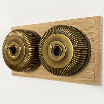 Reeded Round Dolly Light Switch on Oak Base Antique Satin Brass 2 Gang