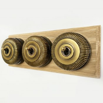 Reeded Round Dolly Light Switch on Oak Base Antique Satin Brass 3 Gang