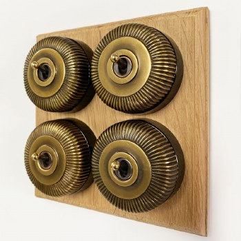 Reeded Round Dolly Light Switch on Oak Base Antique Satin Brass 4 Gang