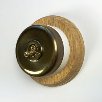 Round Dolly Light Switch on Circular Oak Base Renovated Brass, on White Mount
