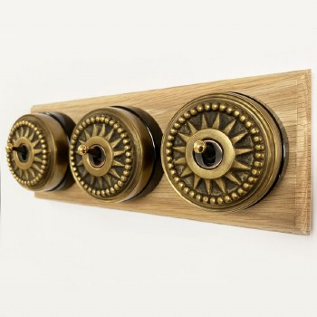 Star Round Dolly Light Switch on Wooden Base Antique Satin Brass 3 Gang