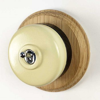 Round Dolly Light Switch Cream on Circular Oak Base with Black Mount