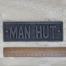 MAN HUT sign Waxed Cast Iron