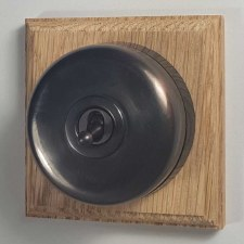 Round Dolly Light Switch on Wooden Base Oil Rubbed Bronze 1 Gang