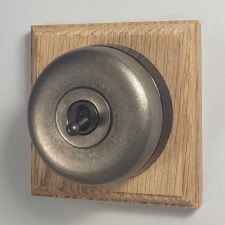 Round Dolly Light Switch on Wooden Base Antique Nickel 1 Gang
