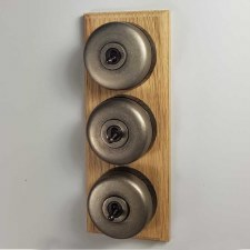 Round Dolly Light Switch on Wooden Base Antique Nickel with Bronzed Switches 3 Gang
