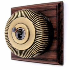 Reeded Round Dolly Light Switch on Wooden Base Antique Satin Brass 1 Gang