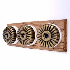 Fluted Round Dolly Light Switch on Wooden Base Antique Satin Brass 3 Gang
