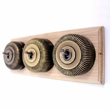 Reeded Round Dolly Light Switch on Wooden Base Antique Satin Brass 3 Gang